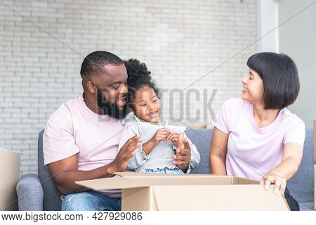 African American Family, Father, Asian Mother And 5-year-old Daughter, They Are Happy Together From