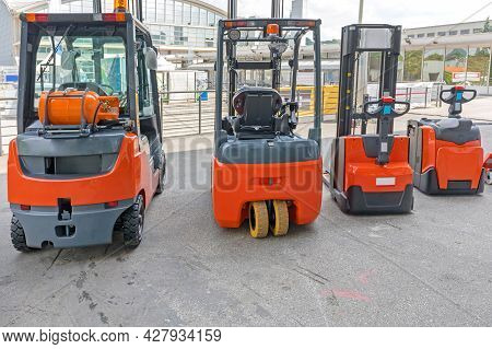 Four Forklift Trucks Gas And Electric Powered Vehicles