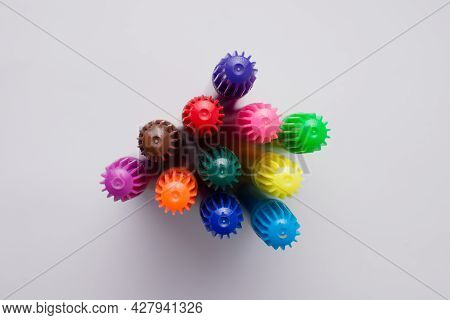 Set Of Colorful Markers Seen From Above. White Background. Copy Space