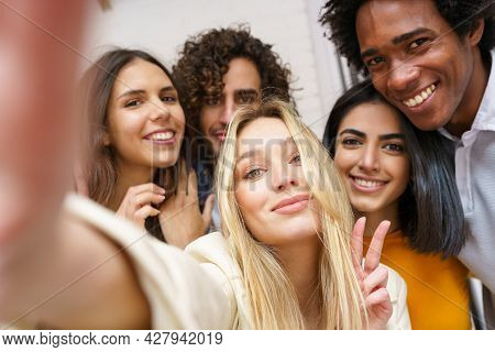 Multi-ethnic Group Of Friends Taking A Selfie Together While Having Fun Outdoors.