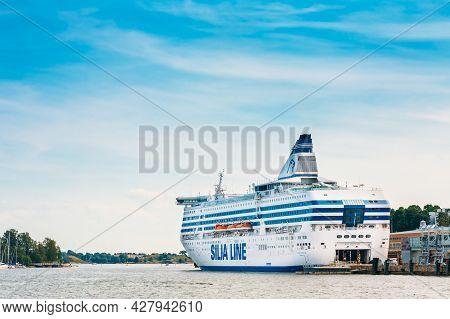 Helsinki, Finland - July 27, 2014: Modern Ferry Boat Silja Line At Pier Awaiting Loading Cargo From