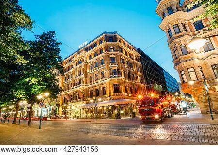 Helsinki, Finland - July 27, 2014: Street View At Night. Buildings In Corner Of Pohjoisesplanadi And
