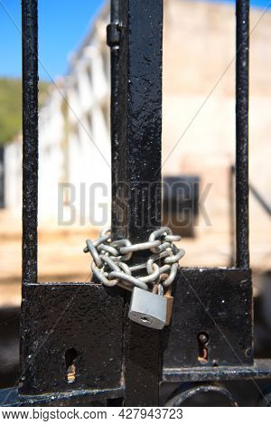 Locked black fence with chain