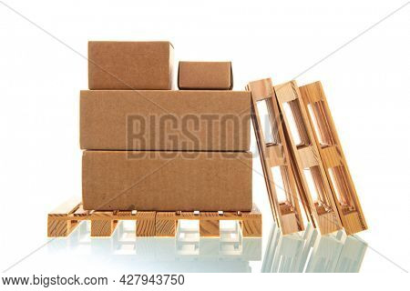 Carton boxes on pallet isolated over white background