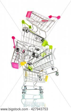 Stack of empty shopping carts isolated white background