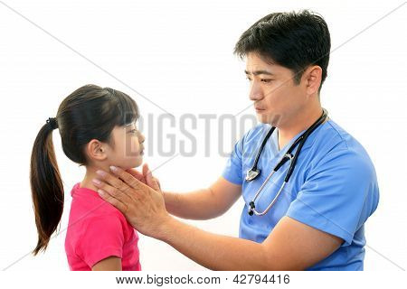 Child having physical examination