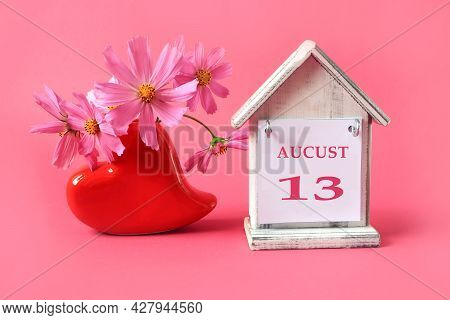 Calendar For: August 13 : The Name Of The Month Of August In English With The Number 13 On A Toy Hou