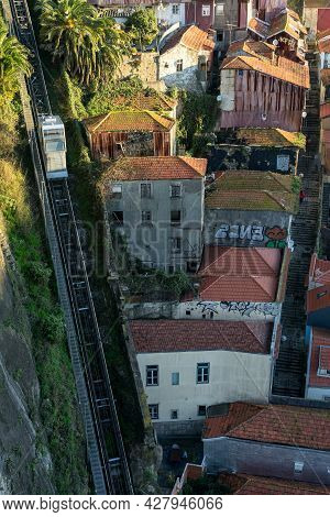 Porto, Portugal - December 02, 2019: View Of The Dos Guindais Funicular And The City Of Porto At Sun