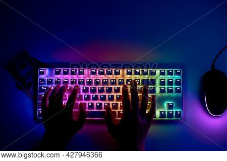 The Concept Of Cyber Attacks And Theft Of Money On The Internet. Keyboard With The Word Hacker. The