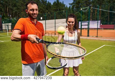 Beginner Woman Player Learning To Play Tennis