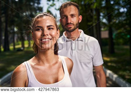 Joyous Pleased Attractive Woman And Her Boyfriend Standing Outside