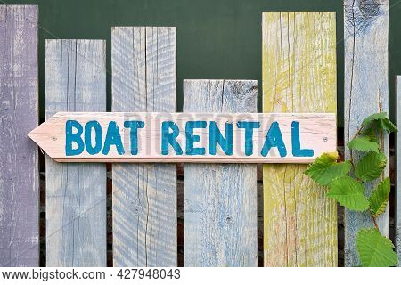 Sign With The Inscription Boat Rental On A Wooden Fence On The River Spree In Berlin Kreuzberg In Ge