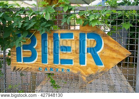 Sign With Directional Arrow With The Inscription Bier Garten (beer Garden) In The City Center Of Ber