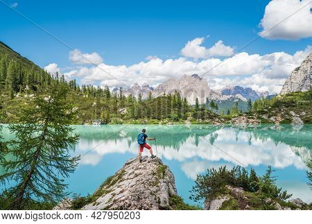 Backpacker With Backpack Enjoying The Turquoise Lago Di Sorapiss 1,925m Altitude (mountain Lake) Vie