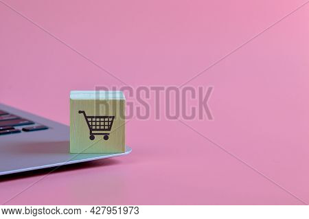 Wooden Block With Shopping Cart Symbol. Online Shopping, Electronic Commerce Or E-commerce Concept