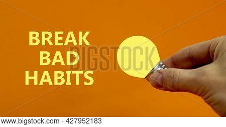 Break Bad Habits Symbol. Businessman Holds Yellow Shining Light Bulb. Words 'break Bad Habits'. Beau