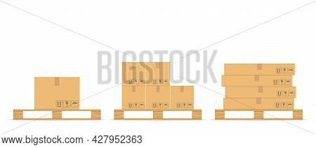 Cardboard Boxes Set With Fragile Signs On Wooden Pallet. Delivery Packaging Box. Warehouse Goods And