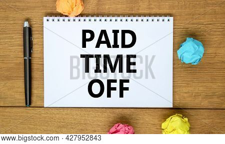 Paid Time Off Symbol. Words 'paid Time Off' On White Note On Beautiful Wooden Table, Colored Paper,