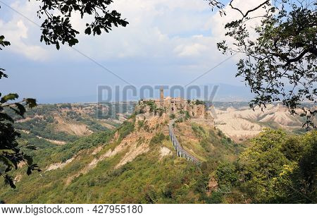 Small Hilltop Village Called Civita Di Bagnoregio In Central Italy Reachable Only By Using A Long Br