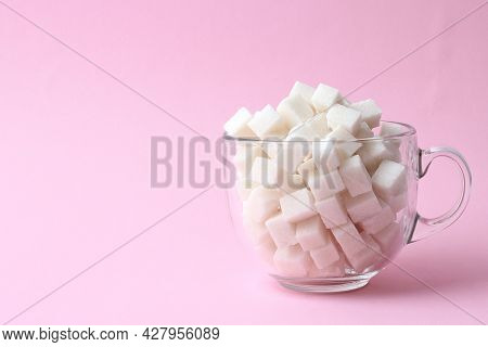 Refined Sugar In A Glass On A Colored Background. Diabetes Concept, Excess Sugar