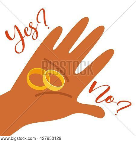 Two Wedding Rings For A Marriage Proposal On The Hand.