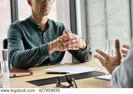 Focused Executive Businessman Client Clasped Hands Negotiating, Thinking, Making Decision Sitting At