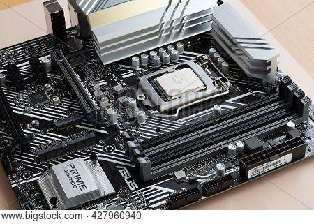 St. Petersburg, Russia - July 17, 2021: Latest Intel I7 11700k Processor Chip In Socket On Asus Prim