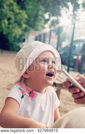Being Young Means Enjoying Days Full Of Fun. Beautiful Baby Girl Smiling Happily
