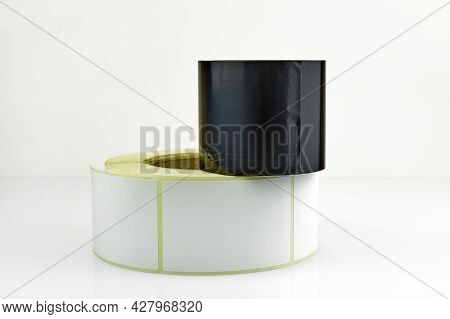 White Roll Of Labels For Thermal Perforation And Ribbon, Thermal Transfer Dye Tape. Stickers For The