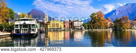 Scenic lake Lago di Garda, view of charming town resort Riva del Garda and small harbour. Trentino, Italy nov 2020
