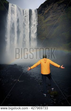 Tourist in front of Skogafoss Waterfall in Iceland, Europe