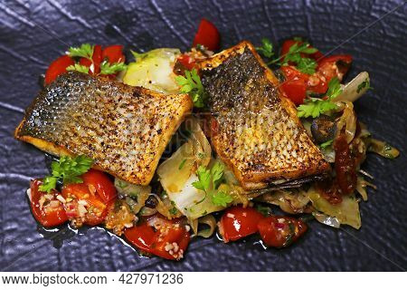 Pan Fried Sea Bass Fillet With Mediterranean Style Sauteed Fennel, Chicory And Cherry Tomato With Le