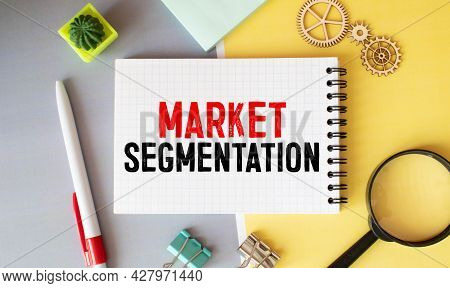 White Paper With Text Market Segmentation On A Black Background With Stationery.