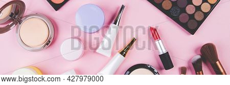 Set Of Cosmetic Makeup Tool Isolated On Pink Background, Top View, Flat Lay, Brush And Lipstick And