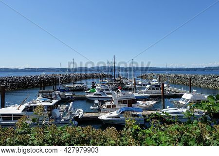 Powell River, British Columbia, Canada - July 5th, 2021: A Marina With Docks Full Of Boats On A Beau