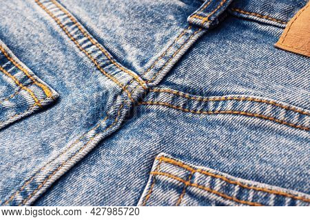 Close-up Of The Denim Pockets, Seams. Elements Of Denim Clothing. Jeans Background For Sewing. Natur