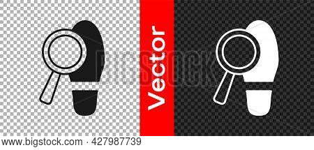 Black Magnifying Glass With Footsteps Icon Isolated On Transparent Background. Detective Is Investig