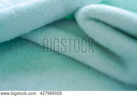 Green Towel Background. Wave Soft Fabric. New Modern Design Luxurious Light And Soft Wave Smooth Sha