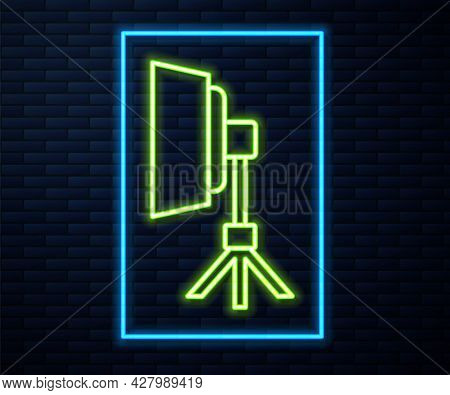 Glowing Neon Line Studio Light Bulb In Softbox Icon Isolated On Brick Wall Background. Shadow Reflec