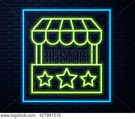 Glowing Neon Line Ticket Box Office Icon Isolated On Brick Wall Background. Ticket Booth For The Sal