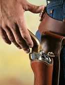 cowboys hand at waist level reaching for gun as if to draw poster