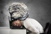 Concept of stress with businessman with a rock on the head poster