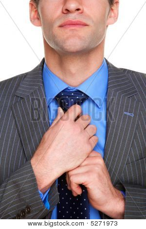 Businessman Doing His Tie Up