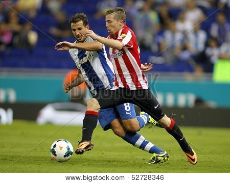 BARCELONA - SEP, 23: Iker Muniain(R) of Bilbao vies with Stuani(L) of Espanyol during a Spanish League match at the Estadi Cornella on September 23, 2013 in Barcelona, Spain