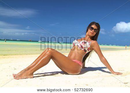 The beautiful girl in bikini on a beach