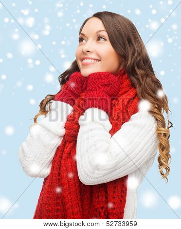 winter, people, happiness concept - happy woman in sweater, scarf and mittens