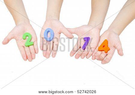 Hand holding 2014 on white background