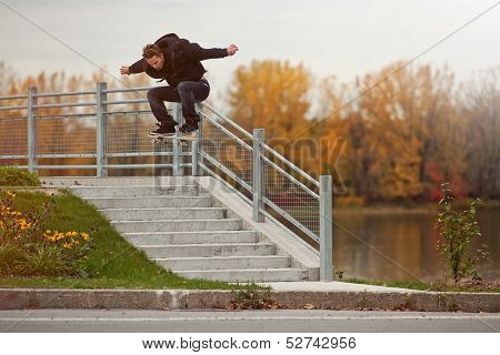 Skateboarder Doing A Ollie Down The Stairs
