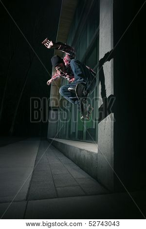 Skateboarder Doing A Wallie On A Wall