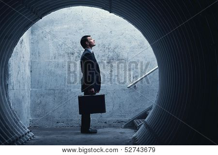 Side View Of A Businessman Looking Up There